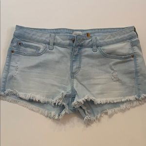 Low rise faded jean shorts